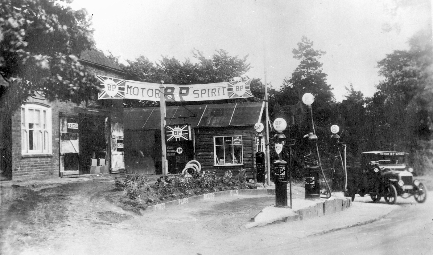 """Willy Henson bought the Wheelwright's on this site and established a petrol station. A good location because vehicles had difficulty reaching the top of what was then a very steep hill. The BP lorry is a Karrier made by Commer. It also delivered to Goodacre's petrol station in front of """"The…"""